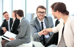 Business People Meeting Discussion Corporate Handshake Concept. Image of business partners handshaking after signing contract Stock Image