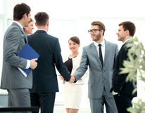 Business People Meeting Discussion Corporate Handshake Concept. Image of business partners handshaking after signing contract Royalty Free Stock Photography