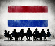 Business People in Meeting with Flag of Netherlands Royalty Free Stock Photo