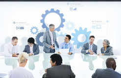 Business People in a Meeting and Gear Symbols Stock Images