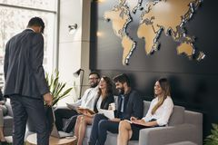 Business people on a meeting. Group of business people on a morning briefing in a modern office royalty free stock photos