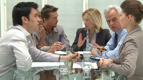 Business People In Meeting. Group Of Coworkers Discussing In Conference Room. Businessmen and businesswomen at business meeting in a conference room. Group of
