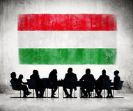 Business People in a Meeting with Hungarian Flag Royalty Free Stock Photos