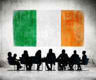 Business People in a Meeting with Irish Flag. Group of Business People in a Meeting with Irish Flag royalty free stock image