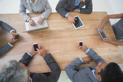 Business people in meeting with new technologies Stock Photography