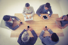 Business people in meeting with new technologies Stock Image