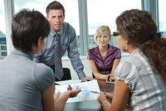 Business people meeting at office. Group of young business people talking on business meeting at office Stock Image