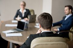 Business people at meeting in office at boardroom negotiate. Business people meeting in office. Close up of men boss leader team sitting his back to camera stock photography
