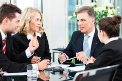 Business people - meeting in an office Stock Photo
