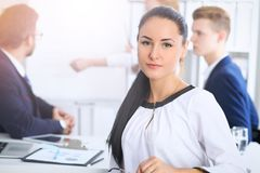 Business People at meeting in office. Focus at beautiful cheerful smiling woman. Conference, corporate training or. Brainstorming of people group. Success and stock images