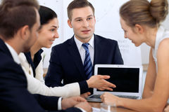 Business people at  meeting in the office. Focus on woman pointing into laptop Stock Images