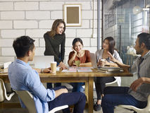 Business people meeting in office. A team of multinational people discussing business in glass meeting room Stock Image