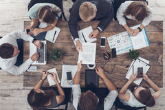 Business people meeting in the office top view Stock Photos
