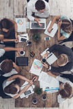 Business people meeting in the office top view. Business people men and women meeting in the office top view using digital device Royalty Free Stock Images