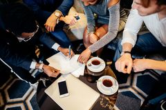 Business people meeting in office top view. Multiethnic Business people meeting in office top view Stock Photos