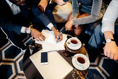 Business people meeting in office top view. Multiethnic Business people meeting in office top view Stock Image