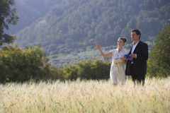 Business people meeting in rural field Royalty Free Stock Photo