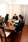 Business people at meeting table Stock Photo