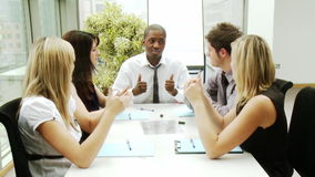 Business people in a meeting with thumbs up stock footage