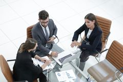 Business people meeting to discuss the situation on the market Royalty Free Stock Photos