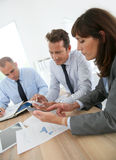 Business people in meeting using electronical devices Royalty Free Stock Photography