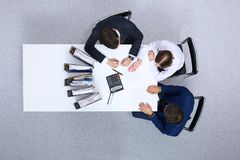 Business people at meeting, view from  above. Bookkeeper or financial inspector  making report, calculating or checki Stock Images