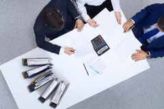 Business people at meeting, view from above. Bookkeeper or financial inspector making report, calculating or checki. Ng balance. Internal Revenue Service stock photo