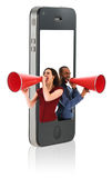 Business people with Megaphones. Businesspeople yelling in a red megaphone from a mobile phone Royalty Free Stock Photography