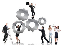 Business people beside metal gears Stock Photography