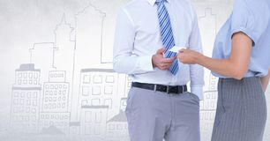 Business people mid sections swapping card against white wall with city doodle Stock Image