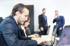 Business people in modern corporate office. Royalty Free Stock Photos
