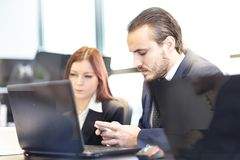 Business people in modern office. Royalty Free Stock Image