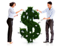 Business people with a money plant Royalty Free Stock Photos