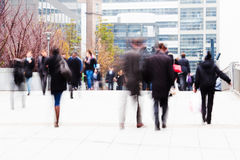 Business people on the move. Business people walking in the office area of La Defense in Paris Royalty Free Stock Photos
