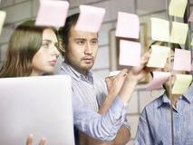 Business people in multinational company working together Stock Images