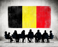 Business People and the National Flag of Belgium Royalty Free Stock Photography