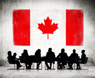 Business People and the National Flag of Canada Stock Image