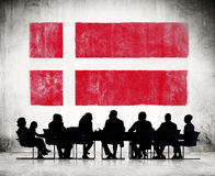 Business People and the National Flag of Denmark Stock Photo