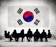 Business People and the National Flag of Korea Stock Photography