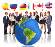 Business people near big earth and flag bubbles Stock Photos