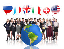 Business people near big earth and flag bubbles Stock Photo