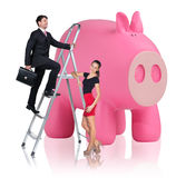 Business people near big piggy bank. Isolated on white Royalty Free Stock Images