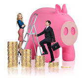 Business people near big piggy bank. Isolated on white Royalty Free Stock Photos