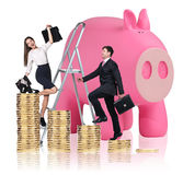 Business people near big piggy bank. Isolated on white Stock Images