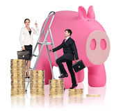 Business people near big piggy bank. Isolated on white Stock Image