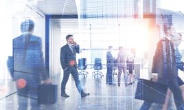 Business people near meeting room, city. Business people walking and discussing documents in modern office with meeting room. Double exposure of cityscape stock photo