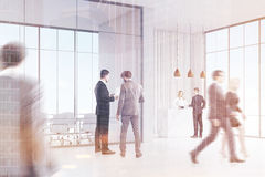 Business people near reception Stock Images