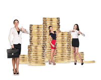 Business people near stack of golden coins Royalty Free Stock Image