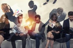 Business people connected on internet network with laptop and tablet. concept of startup company. Double exposure. Business people in office connected on stock photography