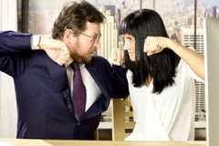 Business people in office fighting Stock Photography
